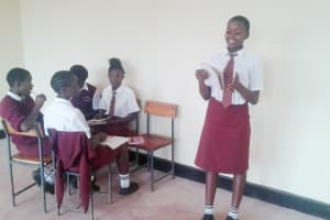 The Water Project: Shikhondi Girls Secondary School -  Trivix Reads Out The Group Answers