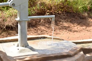 The Water Project: Mbuuni Community E -  Water Flowing