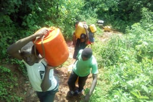 The Water Project: Kwirenyi Secondary School -  Carrying Water Up The Hill From The Stream