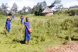 The Water Project: Makuchi Primary School -  Carrying Bricks To The Construction Site