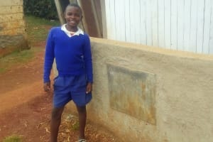 The Water Project: St. Marygoret Girls Secondary School -  One Of The Students Poses Next To The Improved Latrines