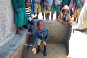 The Water Project: Kalenda Primary School -  Collecting Water