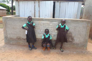 The Water Project: Walodeya Primary School -  Students Pose In Front Of Latrines