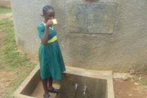 The Water Project: Mukhombe Primary School -  Sheila Alili Drinking Water From The Tank