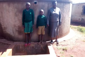 The Water Project: Ebukanga Primary School -  Smiles In Front Of The Tank