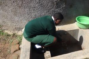 The Water Project: Ibinzo Girls Secondary School -  Maureen Lumula Fetches Water