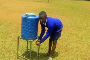 The Water Project: Essunza Primary School -  A Student Washes His Hands At The Handwashing Station
