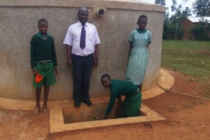 The Water Project: Emukangu Primary School, Butere -  Fetching Water From The Tank