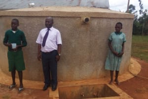 The Water Project: Emukangu Primary School, Butere -  Patrick Anyembe And Students In Front Of Tank