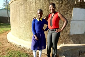 The Water Project: Shiyunzu Primary School -  Emma Ayesa And Field Officer Jemmimah Khasoha Pose In Front Of The Tank