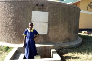The Water Project: Shiyunzu Primary School -  Emma Ayesa At The Tank