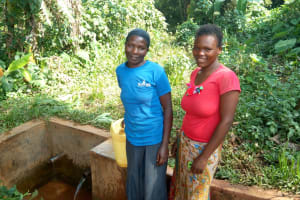 The Water Project: Munzakula Community, Musonye Spring -  Chebet Cheruto Poses By The Spring