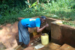 The Water Project: Munzakula Community, Musonye Spring -  Fetching Water From The Spring