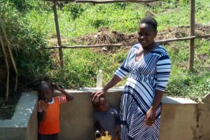 The Water Project: Emarembwa Community, Nyangweso Spring -  Celinia Makomere And Her Family Stand At The Spring