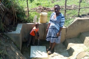 The Water Project: Emarembwa Community, Nyangweso Spring -  Celinia Makomere And Her Son