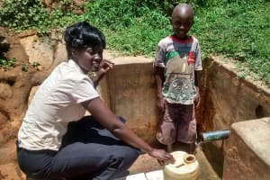 The Water Project: Shikhuyu Community -  Smiles For Reliable Water