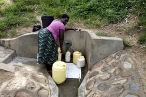 The Water Project: Elukho Community -  Mary Khasiala Fetches Water From The Spring