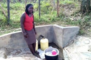 The Water Project: Bukhakunga Community, Indiatsi Omukitsa Spring -  Fetching Water