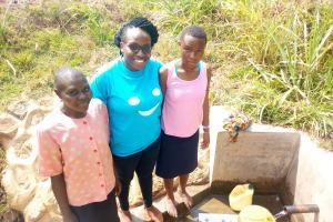The Water Project: Tsivaka Community, Wefwafwa Spring -  Leah Joshua Field Officer Christine Luvandwa And Milldred Lumbasi