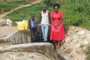 The Water Project: Shitungu Community B, Charles Amala Spring -  Eugine Amala Enock Amala And Field Officer Karen Maruti