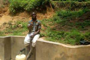 The Water Project: Shikoti Community, Alunyoli Spring -  Boniface Shikuku