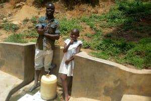 The Water Project: Shikoti Community, Alunyoli Spring -  Purity Khavai And Boniface Shikuku