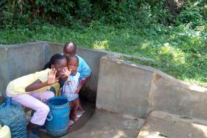 The Water Project: Shikhambi Community, Daniel Inganga Spring -  Rice Russel Terryl And Carlos