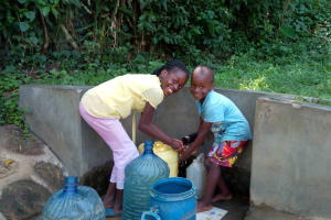 The Water Project: Shikhambi Community, Daniel Inganga Spring -  Rice Russel And Carlos
