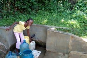 The Water Project: Shikhambi Community, Daniel Inganga Spring -  Rice Russel