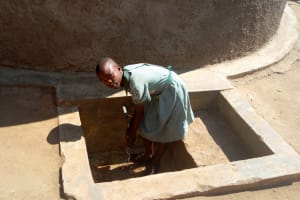 The Water Project: Eshilakwe Primary School -  Aluine Omungala Fetches Water