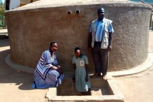 The Water Project: Eshilakwe Primary School -  Standing With Rainwater Tank