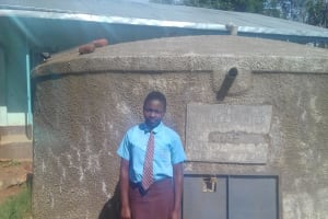 The Water Project: Friends Emanda Secondary School -  Christine Aleyo Posing In Front Of The Tank