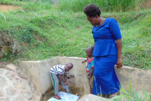 The Water Project: Bushevo Community, David Enani Spring -  James Enani His Mother And Brother