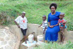 The Water Project: Bushevo Community, David Enani Spring -  Moses Enani And His Family At The Spring