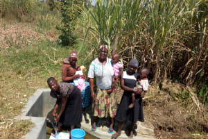 The Water Project: Chegulo Community, Shakava Spring -  Women From The Community Lined Up To Fetch Water From The Spring