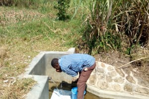 The Water Project: Chegulo Community, Shakava Spring -  Drinking Directly From The Spring