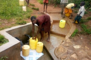 The Water Project: Timbito Community, Atechere Spring -  Fetching Water At The Spring