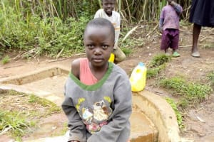The Water Project: Timbito Community, Atechere Spring -  Victoria Kageha Fetching Water
