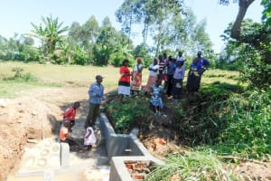 The Water Project: Chegulo Community, Yeni Spring -  Training On How To Care For The Spring