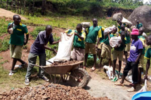 The Water Project: Gemeni Salvation Primary School -  Carrying Materials To The Artisan