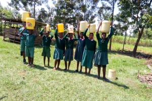 The Water Project: Mavusi Primary School -  Carrying Water