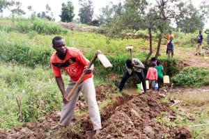 The Water Project: Mungaha B Community, Maria Spring -  Digging Drainage