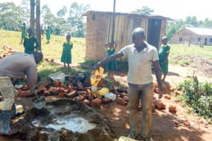 The Water Project: Muyere Primary School -  Mixing Cement