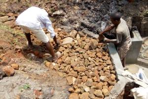 The Water Project: Ewamakhumbi Community, Yanga Spring -  Backfilling