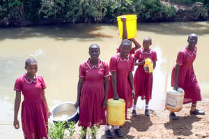 The Water Project: Namarambi Primary School -  Fetching Water