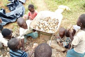 The Water Project: Mungaha B Community, Maria Spring -  Children Sorting Through Stones