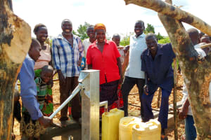The Water Project: Alimugonza Community -  Safe Water Flowing