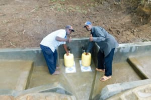 The Water Project: Chegulo Community, Yeni Spring -  Finished Spring Protection