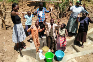 The Water Project: Ematetie Community, Chibusia Spring -  Flowing Water