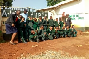 The Water Project: Green Mount Primary School -  Our Team Members Posing With Students At School Gate